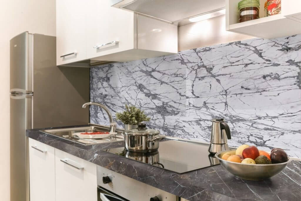 A kitchen using our Invisible Grey Porcelain slabs