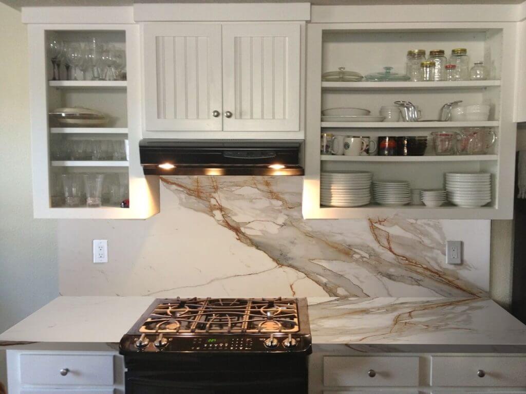 This kitchen features our Macchia Vecchia porcelain stone